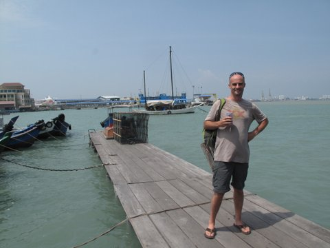 Enjoying a cheap beer at the end of the Cheu Jetty